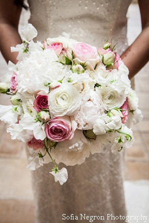 Indian bride with her pink and white flower bouquet