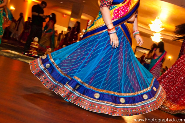 Indian bride twirls in a multicolored blue bridal sari.