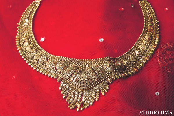 Indian bridal jewelry set includes gold necklace.
