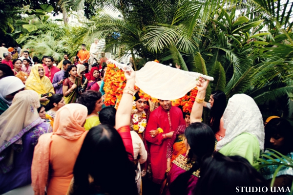 Indian bride and groom enter indian wedding ritual called haldi.