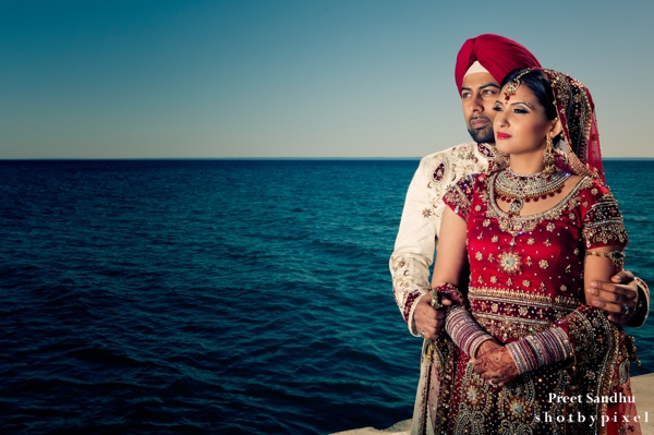 Indian bride and groom portraits by the sea.