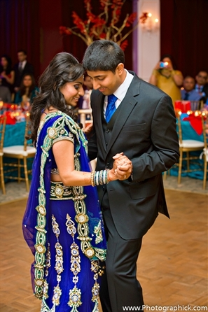 Indian bride and groom dance at their indian wedding reception.