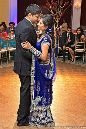 Indian bride wears royal blue indian bridal lengha.