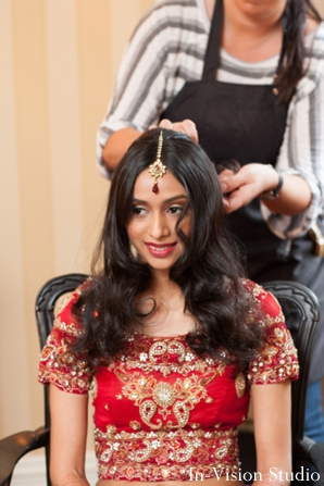 indian bride in red wedding lengha get indian bridal hair completed