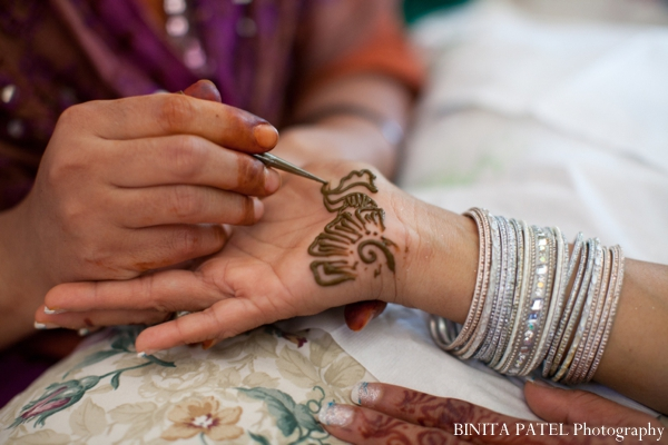 Bridal mehndi received by henna artist.