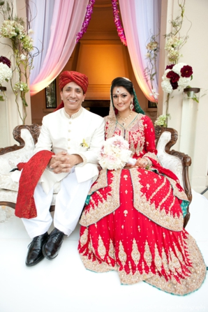 pakistani bride wears red wedding lengha at her ring exchange ceremony.