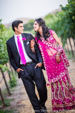 indian bride in fuschia wedding lengha.