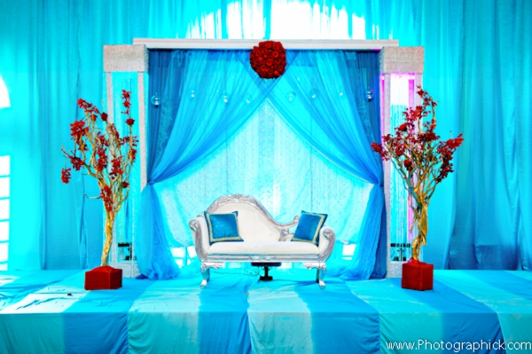 Decor ideas for Indian wedding reception in blue, turquoise and red.
