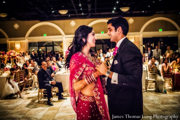 indian bride dances in her pink wedding lengha.