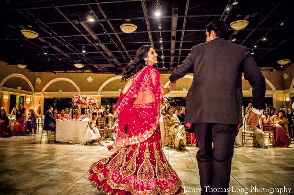indian bride and groom enter modern indian wedding reception.