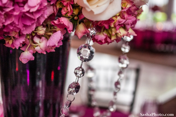 Indian wedding flower centerpiece in pink with crystals.