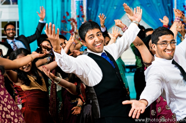 Professional indian wedding photography captures dancing at indian wedding reception.
