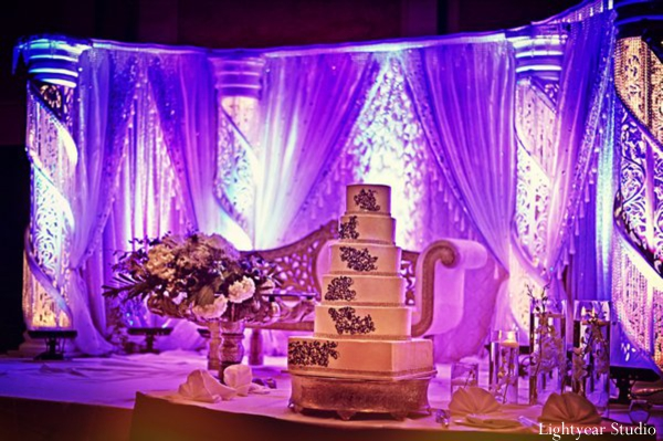 Indian wedding cake and wedding stage at reception.