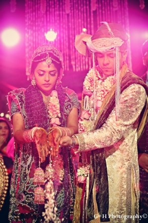 Indian bride wears pink wedding lengha to a pink indian wedding ceremony