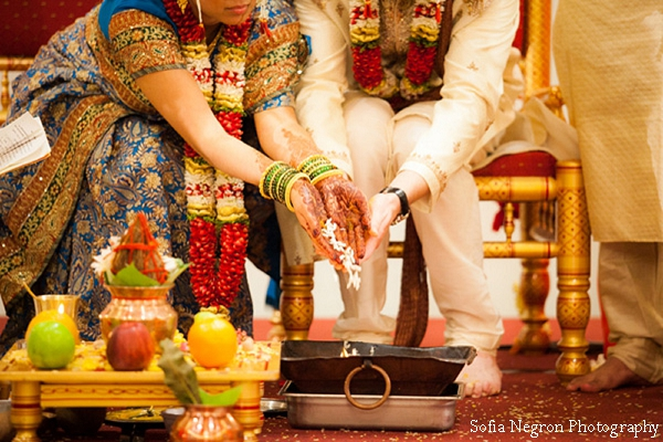 Indian wedding photography captures indian bride and groom at ceremony.