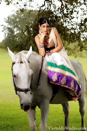 Indian bride on horse for vintage themed photoshoot