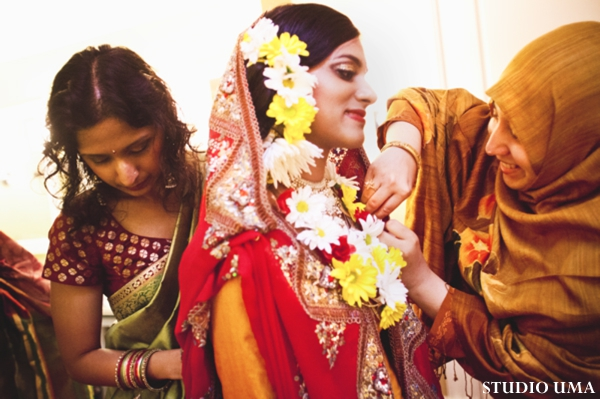 Indian bride readies for pre indian wedding ceremony called a haldi.