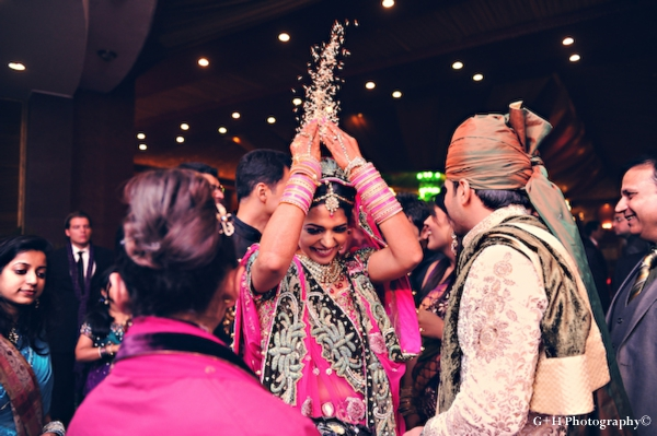 Indian bride tosses rice at her indian wedding ceremony