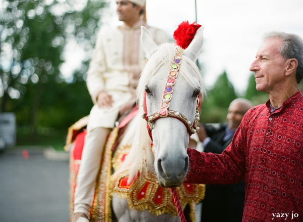 Indian groom arrives on baraat to indian wedding venue