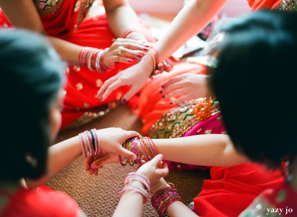 Indian bridal party put on traditional indian wedding jewelry