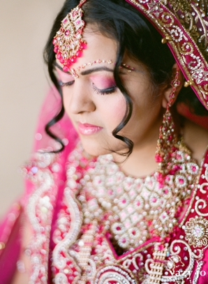 Indian bridal hair and makeup ideas for a pink wedding.