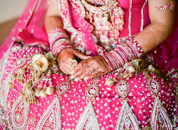 Indian wedding portrait of an indian bride in pink wedding lengha and bridal jewelry