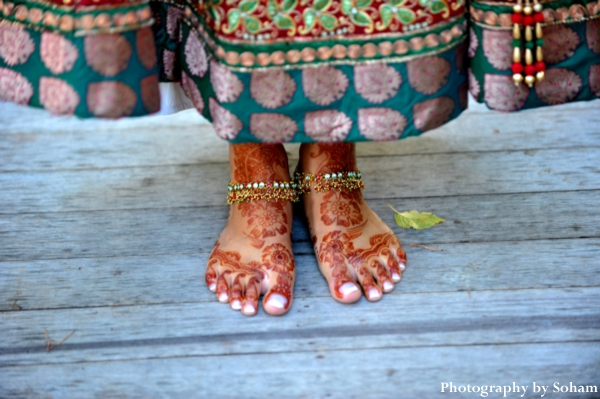 Indian bridal mehndi, or bridal henna, on feet on indian bride.