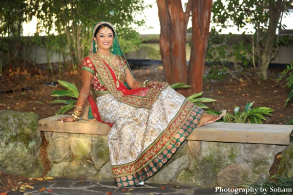 Indian wedding portrait of indian bride in wedding lengha.