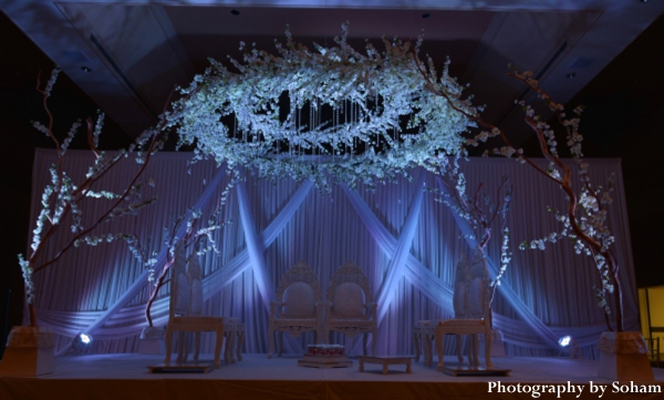 Indian wedding mandap ideas with flowers and branches.