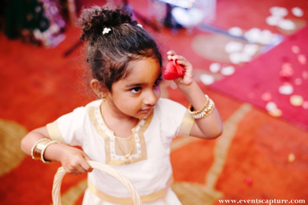 Indian wedding flower girl in white outfit