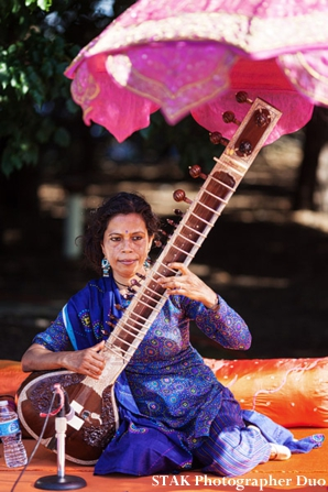 Sitar player at indian wedding ceremony