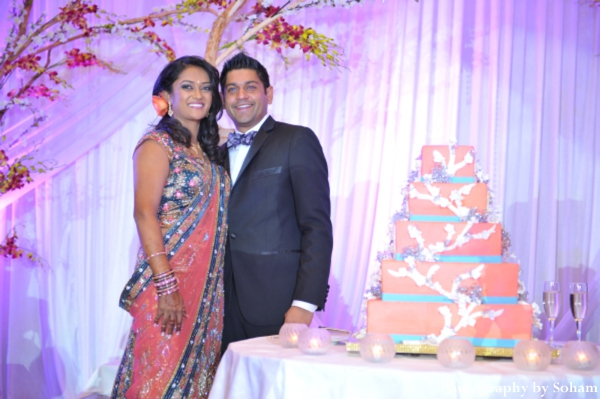 Indian wedding cake with indian bride and groom at indian wedding reception.