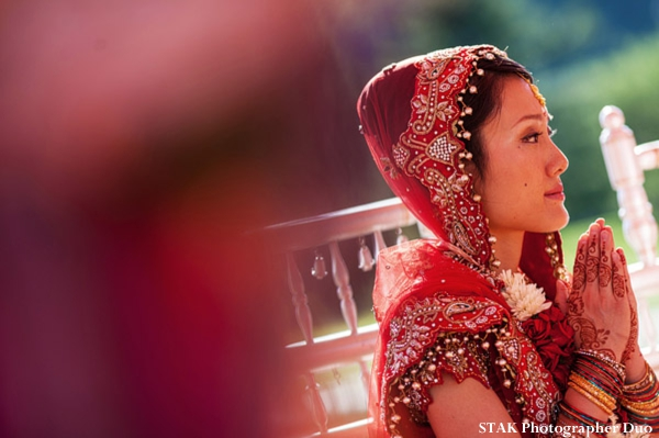 Fusion indian bride in wedding lengha and with bridal mehndi