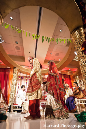 Indian bride and groom under mandap at indian wedding ceremony.