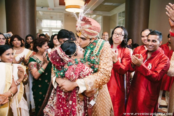 Indian bride and groom embrace before their indian wedding ceremony