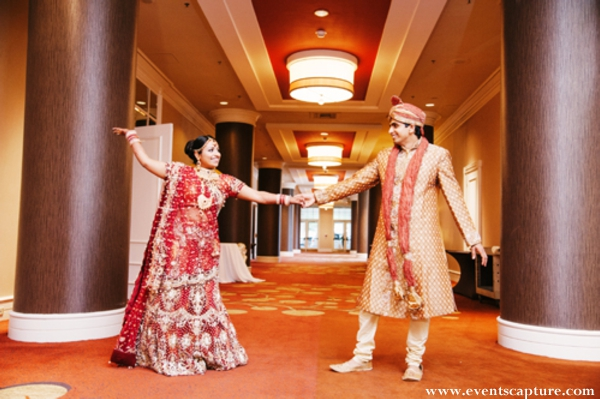 Indian bride in bright red bridal lengha.