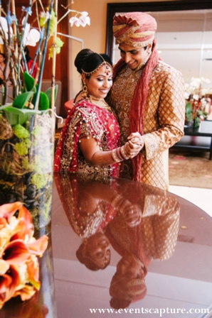 indian bride and groom portrait in traditional wedding clothes.