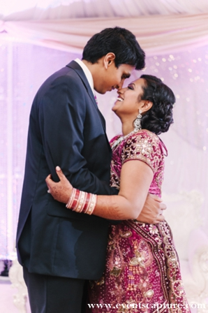 Indian bride in plum and gold wedding lengha.