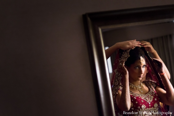Indian bride in a pink wedding lengha.