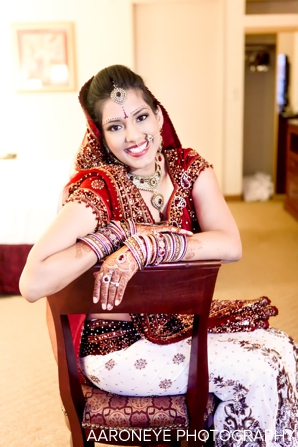 Indian bridal jewelry set and red wedding lengha on indian bride