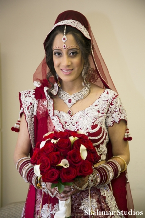 Indian bride portrait in red wedding lengha
