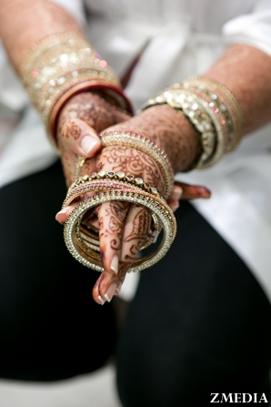 Indian bride with bridal mehndi on hands and traditional bridal jewelry.