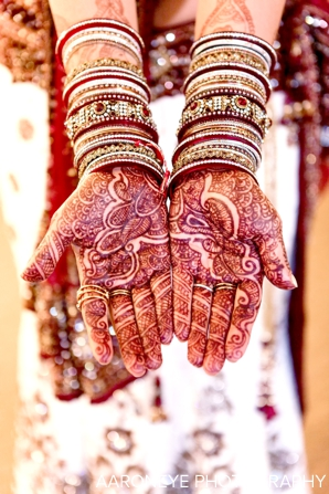 bridal mehndi and churis on indian bride