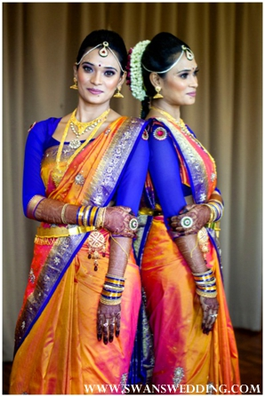 indian bride in orange and blue wedding sari