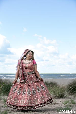 indian bride in pink lengha wedding portrait