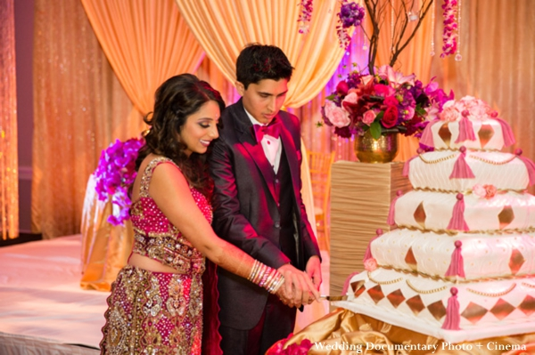 Indian bride and groom cut indian wedding cake