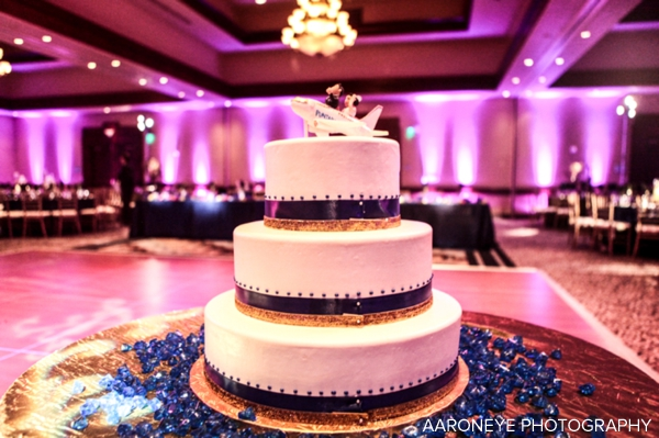 Modern Indian wedding cake with creative wedding cake topper