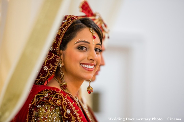Indian bride in traditional red wedding lengha.