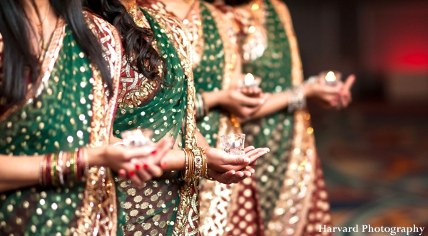 Indian wedding saris for bridesmaids in green and gold.