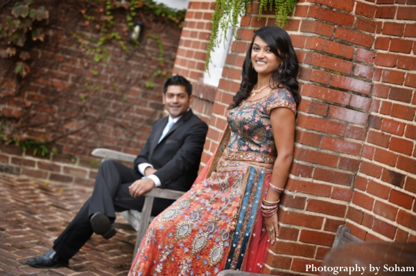 indian bride wears orange wedding lengha to indian wedding reception.